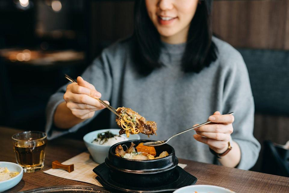 """<p>Restaurant entree portions are typically huge—research has found that nearly all restaurant portions <a href=""""https://www.huffpost.com/entry/restaurant-portion-size_n_1534458"""" data-ylk=""""slk:exceed nutritional standards"""" class=""""link rapid-noclick-resp"""">exceed nutritional standards</a>. If you're keeping portion control in mind, try ordering one or two appetizers instead of an entree. Appetizers are smaller and easier to manage, and they may even already be the correct portion. You're much less likely to overeat if you're not staring at a huge plate of food.</p>"""