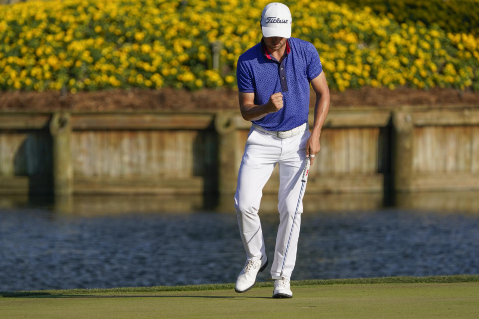Justin Thomas celebrates after a making a putt on the 17th hole during the final round of The Players Championship golf tournament Sunday, March 14, 2021, in Ponte Vedra Beach, Fla. (AP Photo/John Raoux)
