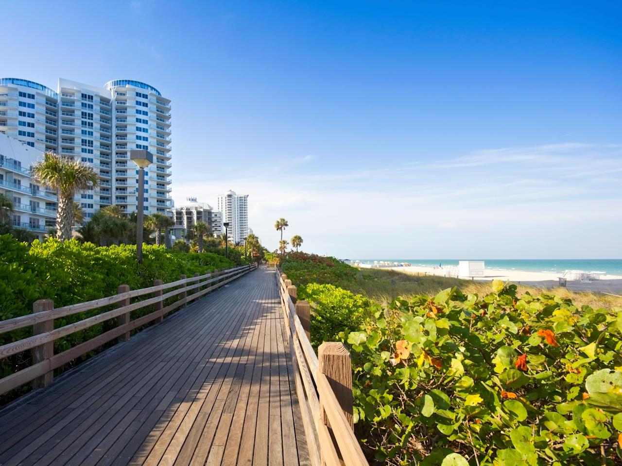 """<p>A raised boardwalk separates the beach from hotel-lined Collins Avenue between 23rd Street and 46th Street, an area collectively referred to as Mid-Beach. Home to Miami's most stylish hotels, like the <a href=""""https://www.cntraveler.com/hotels/miami-beach/the-miami-beach-edition?mbid=synd_yahoo_rss"""" target=""""_blank"""">Miami Beach Edition</a>, <a href=""""https://www.cntraveler.com/hotels/miami-beach/faena-hotel-miami-beach?mbid=synd_yahoo_rss"""" target=""""_blank"""">Faena Hotel Miami Beach</a>, and <a href=""""https://www.cntraveler.com/hotels/united-states/miami-beach/soho-beach-house?mbid=synd_yahoo_rss"""" target=""""_blank"""">Soho Beach House</a>, this area caters to a cool crowd that considers South Beach passé.</p> <p><strong>Who it's best for:</strong> Fashionistas, trendsetters, and those who like to chill and drink at hotel beach clubs</p> <p><strong>The vibe:</strong> A lounge-y atmosphere that goes from day to night, given the prolific beach and pool clubs to choose from</p> <p><strong>Where to stay:</strong> Check into the <a href=""""https://www.cntraveler.com/hotels/miami-beach/the-miami-beach-edition?mbid=synd_yahoo_rss"""" target=""""_blank"""">Miami Beach Edition</a>, an Ian Schrager–backed reinvention of the 1955 Seville Hotel, with an Old Havana–inspired palm-fringed lobby, a slick pool area, and, of course, the beach.</p>"""