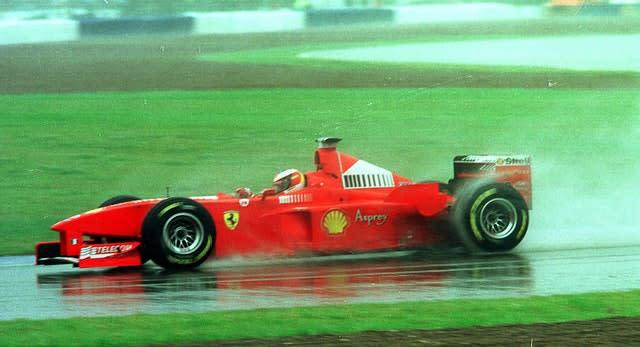 Michael Schumacher took victory in bizarre circumstances after heavy rain hit the race in 1998 (Owen Humphreys/PA)