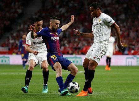 Soccer Football - Spanish King's Cup Final - FC Barcelona v Sevilla - Wanda Metropolitano, Madrid, Spain - April 21, 2018 Barcelona's Jordi Alba in action with Sevilla's Luis Muriel REUTERS/Juan Medina
