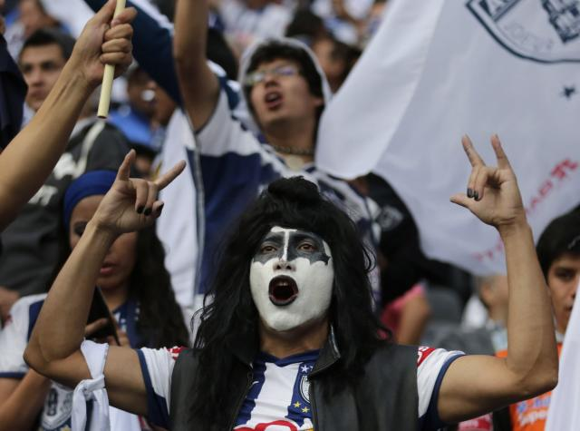 A Pachuca fan cheers before the team's Mexican league championship final soccer match against Leon at the Hidalgo stadium in Pachuca May 18, 2014. REUTERS/Henry Romero (MEXICO - Tags: SPORT SOCCER)