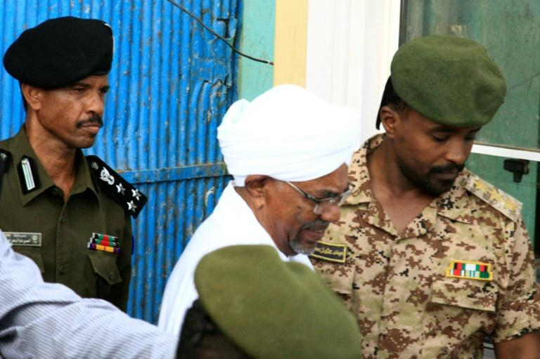 Ousted Sudanese leader Omar al-Bashir who appeared in court Monday for the start of his trial on corruption charges is seen in this June 2019 picture being escorted from the Kober prison to the prosecutor's office in North Khartoum