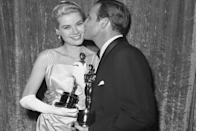 "<p> Marlon Brando and <a href=""https://www.goodhousekeeping.com/beauty/fashion/g4719/grace-kelly-wedding-gown/"" rel=""nofollow noopener"" target=""_blank"" data-ylk=""slk:Grace Kelly"" class=""link rapid-noclick-resp"">Grace Kelly</a> celebrated their Oscars with a kiss. <a href=""https://www.amazon.com/Waterfront-Marlon-Brando/dp/B000I9VXSQ/ref=sr_1_2?s=instant-video&ie=UTF8&qid=1547578098&sr=1-2&keywords=On+the+Waterfront&tag=syn-yahoo-20&ascsubtag=%5Bartid%7C10055.g.5132%5Bsrc%7Cyahoo-us"" rel=""nofollow noopener"" target=""_blank"" data-ylk=""slk:On the Waterfront"" class=""link rapid-noclick-resp""><em>On the Waterfront</em> </a>was the big winner of the night. The film won Best Picture, Best Actor (Brando), Best Supporting Actress (Eva Marie Saint), and Best Director (Eliza Kazan). Grace took home the Oscar for Best Actress for her role in <em><a href=""https://www.amazon.com/dp/B001KJU9IS?ref=sr_1_1_acs_kn_imdb_pa_dp&qid=1547578117&sr=1-1-acs&autoplay=0&tag=syn-yahoo-20&ascsubtag=%5Bartid%7C10055.g.5132%5Bsrc%7Cyahoo-us"" rel=""nofollow noopener"" target=""_blank"" data-ylk=""slk:The Country Girl"" class=""link rapid-noclick-resp"">The Country Girl</a></em>.</p><p><strong>RELATED:</strong> <a href=""https://www.goodhousekeeping.com/beauty/fashion/a46308/grace-kelly-civil-ceremony-wedding-dress/"" rel=""nofollow noopener"" target=""_blank"" data-ylk=""slk:Grace Kelly Wore a Second (Pink!) Wedding Dress"" class=""link rapid-noclick-resp"">Grace Kelly Wore a Second (Pink!) Wedding Dress</a></p>"
