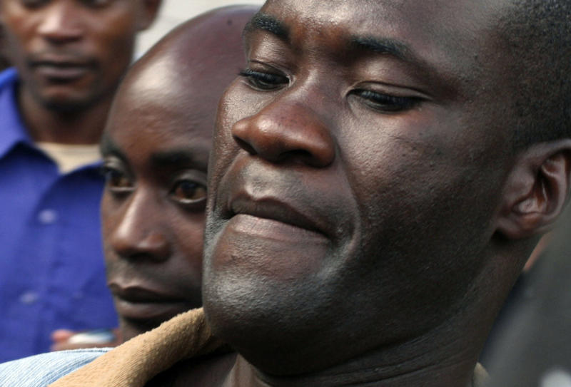 "FILE - In this Thursday May, 20, 2010 file photo, Tiwonge Chimbalanga, foreground, and Steven Monjeza, left background, are led from court in Blantyre, Malawi, after a judge sentenced the couple to the maximum 14 years in prison for unnatural acts and gross indecency under Malawi's anti-gay legislation. The couple were pardoned Saturday May 29, 2010. Malawi's government is moving to suspend laws against homosexuality and police cannot arrest or prosecute people for same-sex acts until the anti-gay laws are discussed in parliament, the justice minister said. The international rights group Human Rights Watch called the decision ""courageous"" and said that it should serve as an inspiration to other countries that criminalize homosexuality.  (AP Photo/Alex Ntonya, File)"