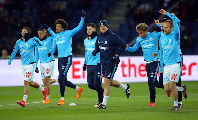 Soccer Football - Ligue 1 - Paris St Germain vs Olympique de Marseille - Parc des Princes, Paris, France - February 25, 2018 Marseille players warm up before the match REUTERS/Stephane Mahe
