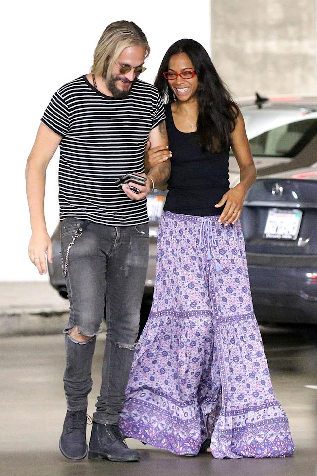 <p>Saldana and her hubby, Marco Perego, showed their love for each other — and for books! — on a library outing in L.A. (Photo: Poersch/BACKGRID) </p>