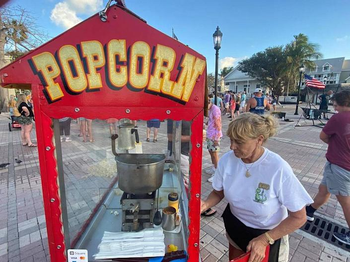 Clara Taylor works her popcorn concession at Mallory Square on March 16, 2020.