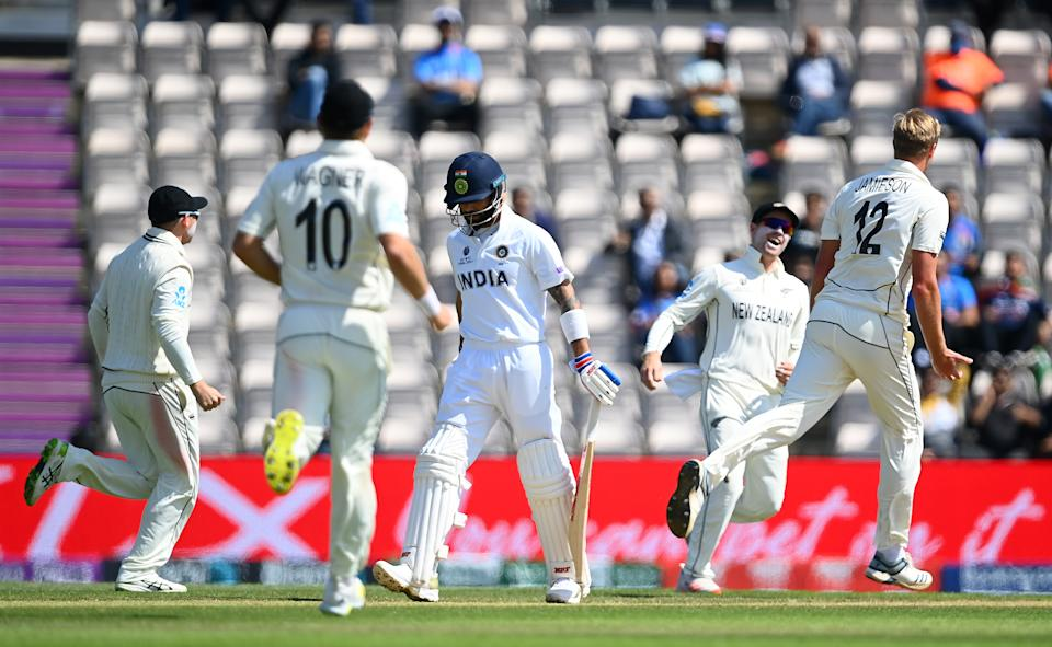 SOUTHAMPTON, ENGLAND - JUNE 23: Virat Kohli of India walks off as Kyle Jamieson of New Zealand celebrates his wicket during the Reserve Day of the ICC World Test Championship Final between India and New Zealand at The Hampshire Bowl on June 23, 2021 in Southampton, England. (Photo by Alex Davidson/Getty Images)
