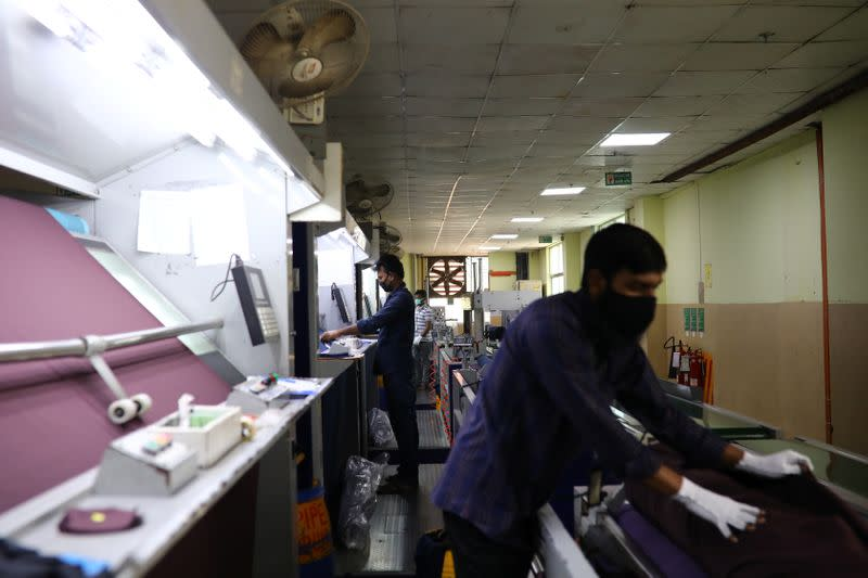 An employee works in a dyeing section of the Fakhruddin Textile Mills Limited in Gazipur