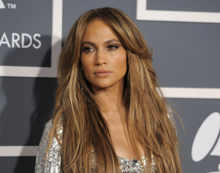 """FILE - In this Sunday, Feb. 13, 2011 file photo, Jennifer Lopez arrives at the 53rd annual Grammy Awards in Los Angeles. Fox announced Tuesday, Sept. 3, 2013 that Lopez, along with Harry Connick Jr. and Keith Urban will be judges on the upcoming season of """"American Idol."""" (AP Photo/Chris Pizzello, File)"""