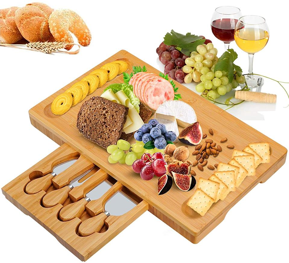 Bamboo Cheese Board Set with Drawer Wooden Charcuterie Tray Platter. Image via Amazon