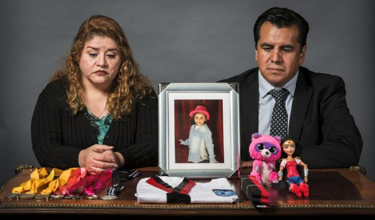 Mireya Rodriguez (L) and Alejandro Jurado lost their seven-year-old daughter Paola in the earthquake