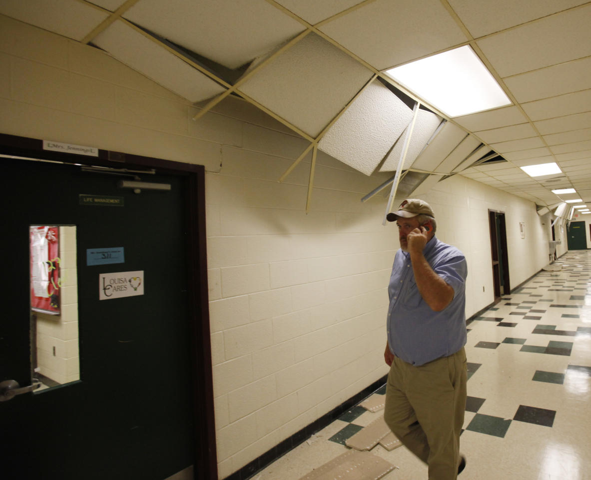 School board member Brian Huffman walks the halls surveying the damage to Louis County High school after a 5.8 magnitude earthquake in Mineral, Virginia Tuesday, Aug. 23, 2011. (AP Photo/Richmond Times-Dispatch, Alexa Welch)