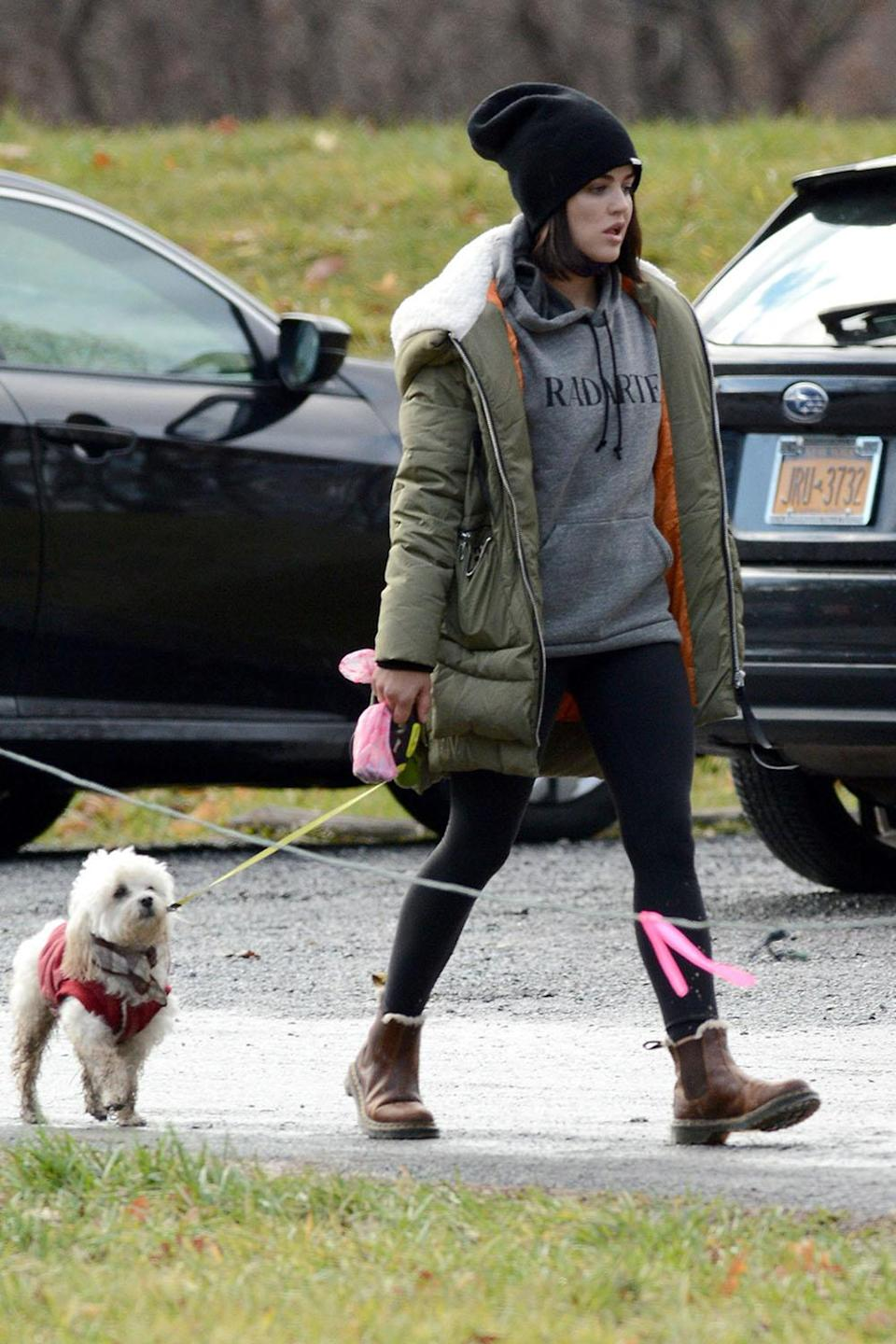 <p>Lucy Hale takes a hike in upstate New York with her pup, Elvis on Thursday. </p>