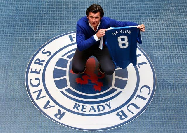 Joe Barton poses with a Rangers shirt