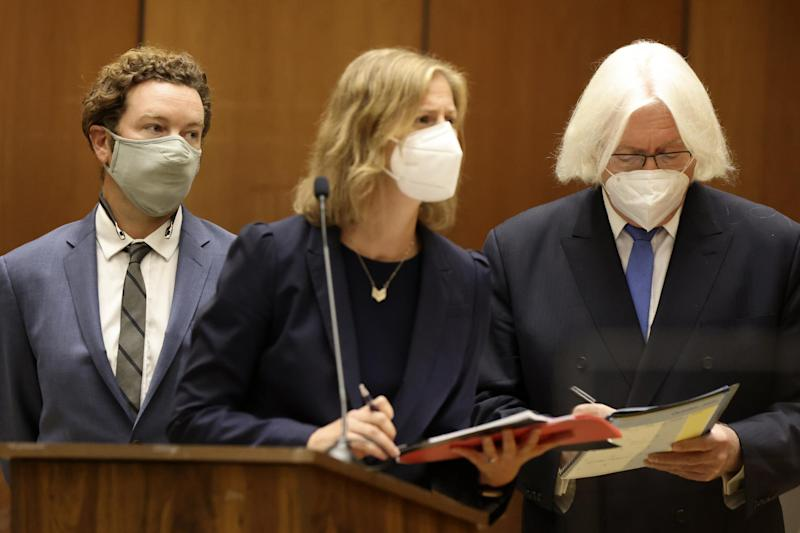 Actor Danny Masterson, left, stands with his lawyers Thomas Mesereau, right, and Sharon Appelbaum during his arraignment in Los Angeles Superior Court (AP)
