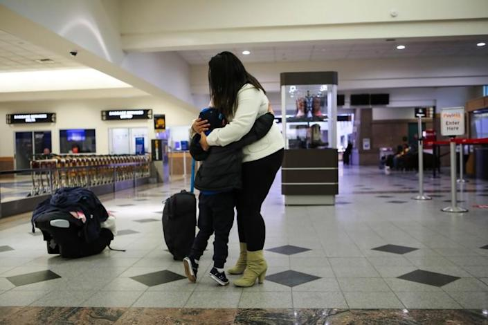A young mother wishing to asylum in Honduras reunited with her five-year-old son on March 24, 2021, after nearly a month away at El Paso International Airport in Texas. Her son came to the United States with his uncle, but was separated and placed in a Texas shelter and later moved to New York.  (JR Hernandez / Los Angeles Times)
