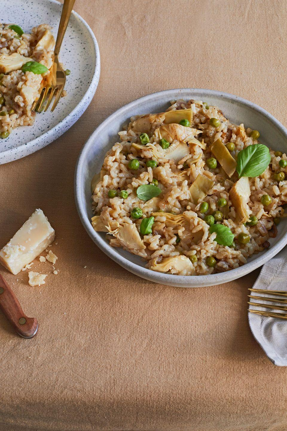 """<p>We love this artichoke and pea <a href=""""https://www.delish.com/uk/cooking/recipes/a34121193/mushroom-asparagus-risotto/"""" rel=""""nofollow noopener"""" target=""""_blank"""" data-ylk=""""slk:risotto"""" class=""""link rapid-noclick-resp"""">risotto</a>. The artichokes in this dish really make this easy risotto recipe feel like an indulgent treat. Use chargrilled <a href=""""https://www.delish.com/uk/cooking/recipes/a35040907/chicken-spinach-and-artichoke-rigatoni-recipe/"""" rel=""""nofollow noopener"""" target=""""_blank"""" data-ylk=""""slk:artichoke"""" class=""""link rapid-noclick-resp"""">artichoke</a> hearts if you can find them for an even better flavour. Lemon and basil lift all the flavours beautifully in this dish.</p><p>Get the <a href=""""https://www.delish.com/uk/cooking/recipes/a35291295/artichoke-pea-risotto/"""" rel=""""nofollow noopener"""" target=""""_blank"""" data-ylk=""""slk:Artichoke & Pea Risotto"""" class=""""link rapid-noclick-resp"""">Artichoke & Pea Risotto</a> recipe. </p>"""