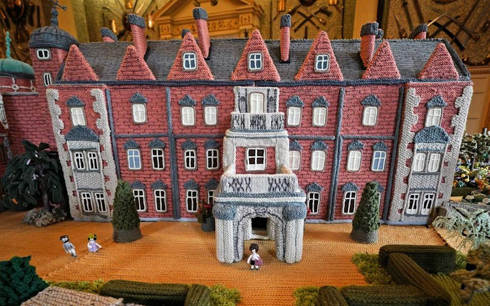 Margaret Seaman spent up to 15 hours a day creating 'Knitted Sandringham', now on display in the ballroom of Sandringham House - PA