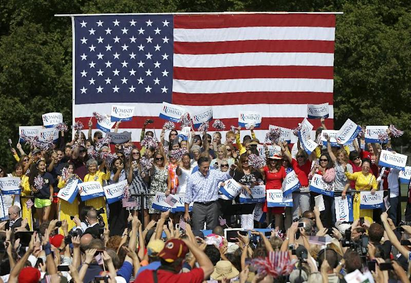 Republican Presidential candidate, former Massachusetts Gov. Mitt Romney, on stage,waves during a campaign event at Van Dyck Park, Thursday, Sept. 13, 2012, in Fairfax, Va. (AP Photo/Pablo Martinez Monsivais)