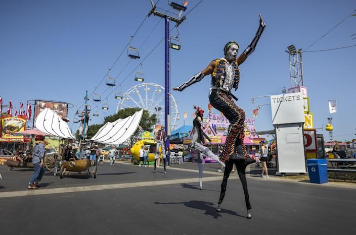 A performer from Dragon Knights Stilt Theater
