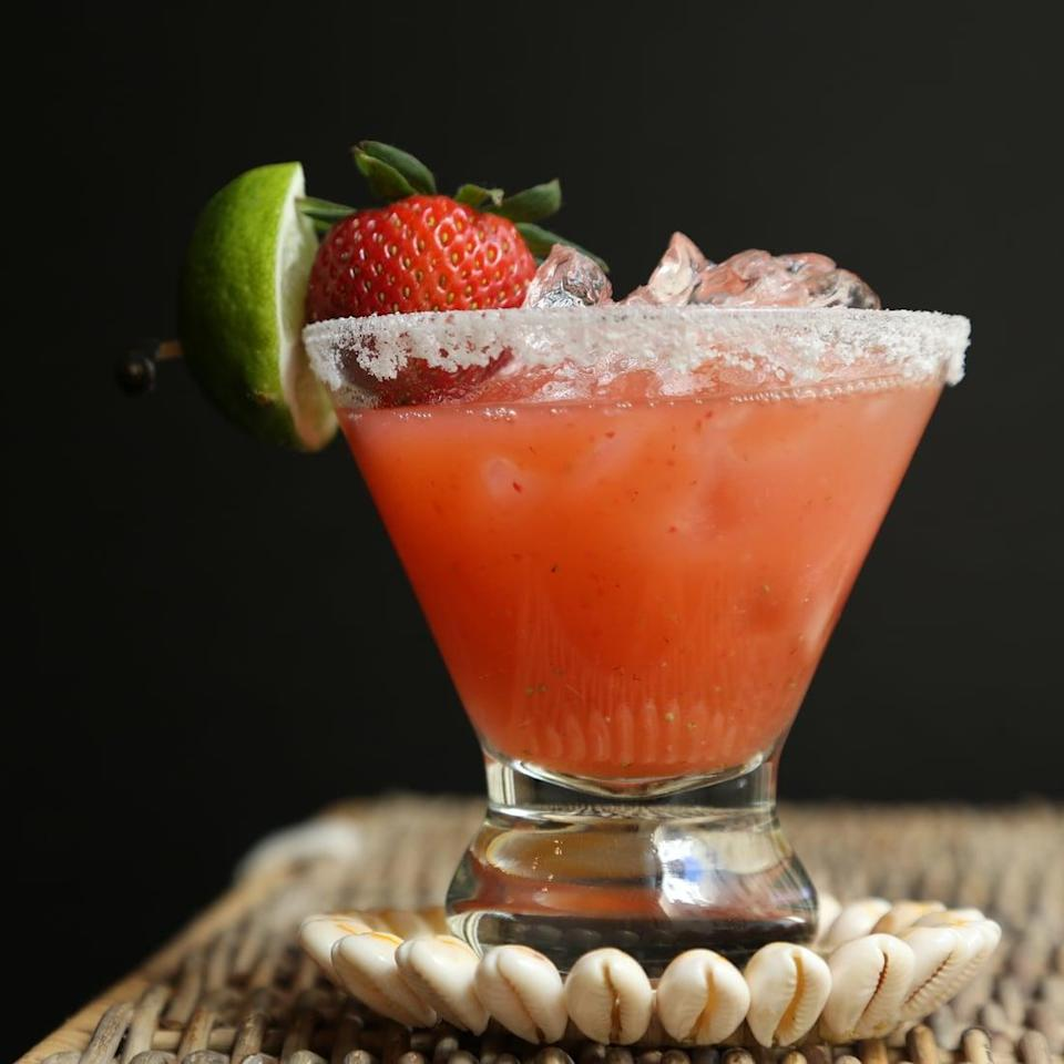 """<p>Take full advantage of summer's best produce offering when you whip up this low-calorie <a href=""""https://www.popsugar.com/food/Strawberry-Margarita-Recipe-17632392"""" class=""""link rapid-noclick-resp"""" rel=""""nofollow noopener"""" target=""""_blank"""" data-ylk=""""slk:strawberry margarita"""">strawberry margarita</a>. Made with fresh berries and a dash of tequila, this is really a dream come true.</p> <p><strong>Ingredients: </strong></p> <ul> <li>1/2 of a pint of strawberries</li> <li>1 cup tequila</li> <li>1/2 cup orange liqueur</li> <li>4 limes, juiced</li> <li>Ice</li> </ul> <p><strong>Directions</strong>: In a blender, blend strawberries, tequila, orange liqueur, and lime juice. Fill a pitcher with ice and pour in the blended margarita. Stir well to ensure that the mixture is combined. Prepare the glasses by rubbing each rim with a lime wedge. Fill a small plate with salt and dip the wet rim of the glass in the salt. Divide margarita into the salted glasses, and garnish each glass with a strawberry and lime wedge. Enjoy immediately!</p>"""