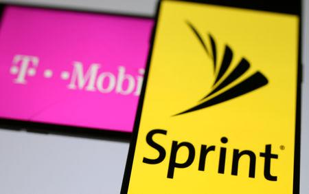 FILE PHOTO: Smartphones with the logos of T-Mobile and Sprint are seen in this illustration taken September 19, 2017. REUTERS/Dado Ruvic/Illustration/File Photo