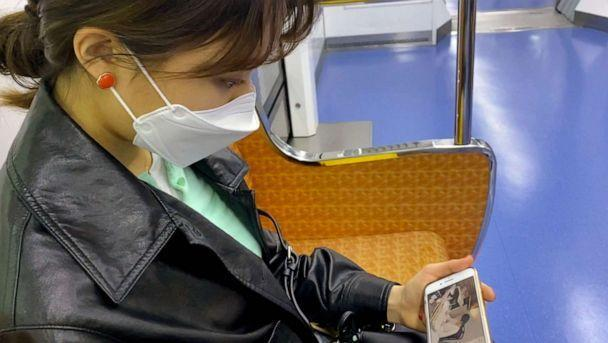 PHOTO: College student Hyun Soo Kim watches 'study with me' YouTube on the subway in  Seoul, April 18, 2021. (ABC News)