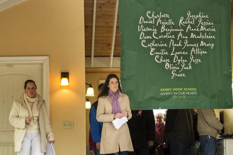 Relatives of the victims killed in the Sandy Hook Elementary School tragedy in Newtown, Connecticut arrive to give a statement regarding the formation of the website mysandyhookfamily.org just before the one year anniversary of the disaster in Sandy Hook, Connecticut December 9, 2013. REUTERS/Lucas Jackson (UNITED STATES - Tags: ANNIVERSARY CRIME LAW)