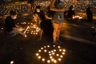 Israelis light memorial candles on the 25th anniversary of the assassination of Israeli Prime Minister Yitzhak Rabin, at Rabin Square, Tel Aviv, Israel, Thursday, Oct. 29, 2020. (AP Photo/Oded Balilty)
