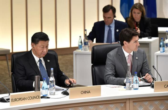 FILE PHOTO: China's President Xi and Canada's Prime Minister Trudeau attend the G20 Summit in Osaka