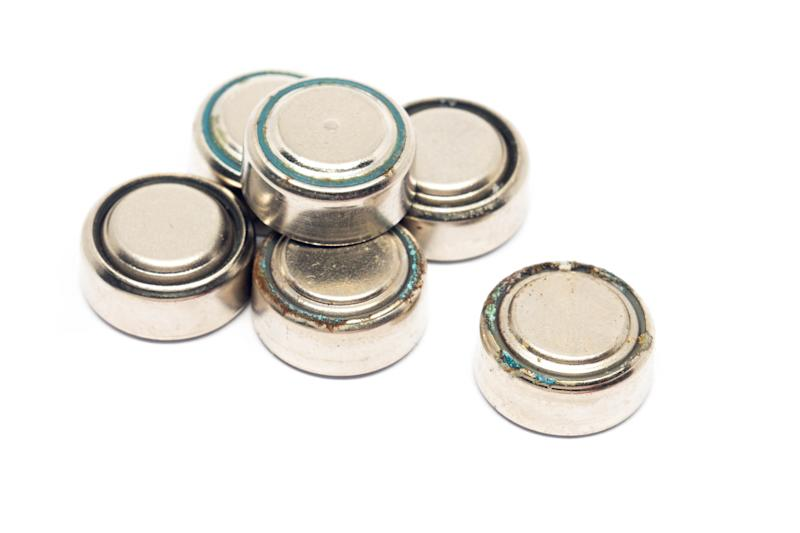 A number of button batteries are pictured.