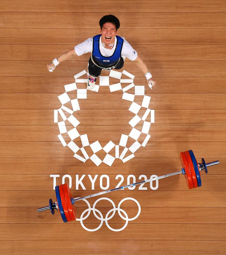 <p>Myeongmok Han of South Korea competes during the weightlifting - men's 67kg group A on July 25. </p>