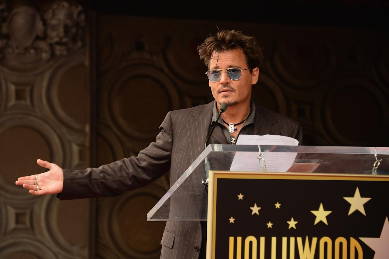 HOLLYWOOD, CA - JUNE 24: Actor Johnny Depp speaks as Jerry Bruckheimer is honored on the Hollywood Walk Of Fame on June 24, 2013 in Hollywood, California. (Photo by Mark Davis/Getty Images)