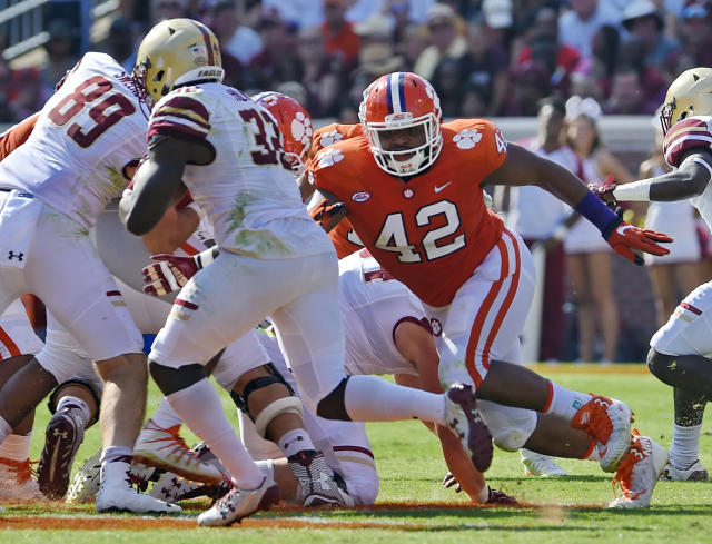 "FILE – In this Sept. 23, 2017, file photo, Clemson's <a class=""link rapid-noclick-resp"" href=""/ncaaf/players/252172/"" data-ylk=""slk:Christian Wilkins"">Christian Wilkins</a> (42) pursues a runner during the first half of an NCAA college football game against Boston College Clemson, S.C. The secret to Clemson retaining its stellar defensive line is not that mysterious, Tigers coach Dabo Swinney says: Expected first-rounders Christian Wilkins, <a class=""link rapid-noclick-resp"" href=""/ncaaf/players/252167/"" data-ylk=""slk:Clelin Ferrell"">Clelin Ferrell</a> and <a class=""link rapid-noclick-resp"" href=""/ncaaf/players/252163/"" data-ylk=""slk:Austin Bryant"">Austin Bryant</a> did not get the grades they anticipated from the NFL committee evaluating their draft chances. (AP Photo/Richard Shiro, File)"