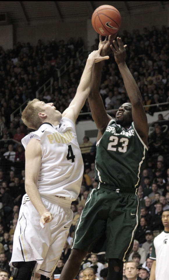 Purdue forward Robbie Hummel, left, gets a finger on Michigan State forward Draymond Green who shoots in the second half of an NCAA college basketball game in West Lafayette, Ind., Sunday, Feb. 19, 2012. Michigan State won 76-62. (AP Photo/AJ Mast)