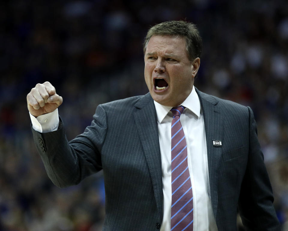 Kansas head coach Bill Self talks to his players during the first half of the NCAA college basketball championship game against West Virginia in the Big 12 men's tournament Saturday, March 10, 2018, in Kansas City, Mo. (AP Photo/Charlie Riedel)