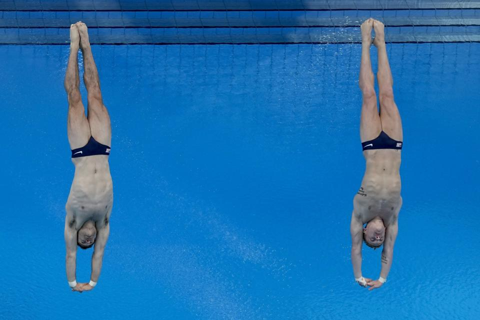 United States' Andrew Capobianco and Michael Hixon compete during men's synchronised 3-meter springboard at the 2020 Summer Olympics, Monday, July 26, 2021, in Tokyo, Japan. (AP Photo/Morry Gash)