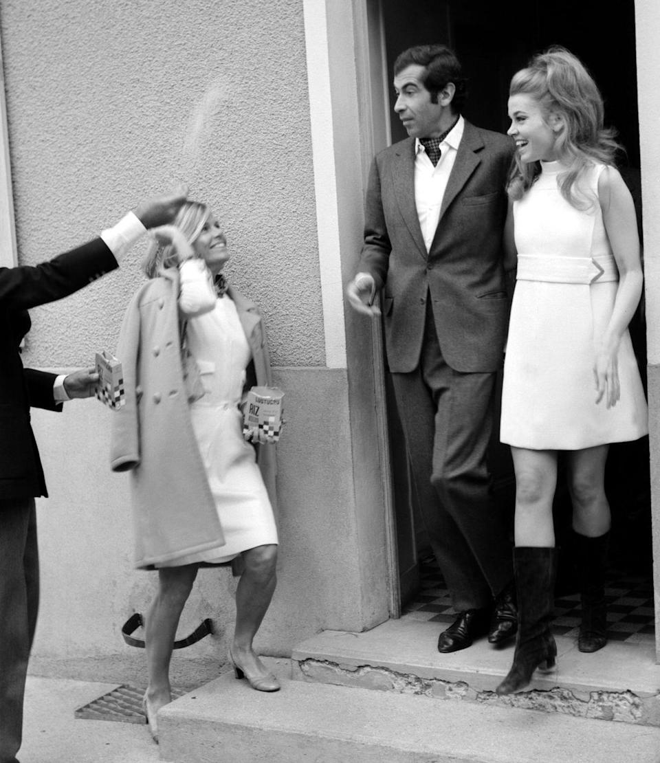 <p>In typical '60s style, actress Jane Fonda wore a high neck, sleeveless white mini dress, and tall black-heeled boots to marry French director Roger Vadim in 1965. </p>
