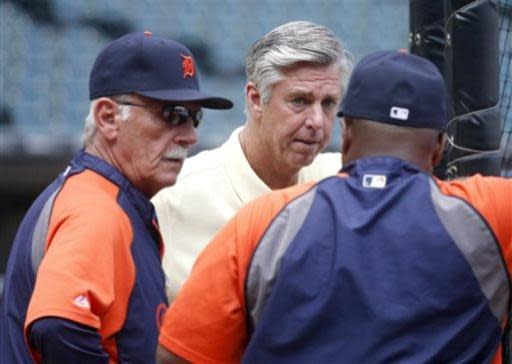 Detroit Tigers manager Jim Leyland, left, and club President and General manager David Dombrowski, center, listen to hitting coach Lloyd McClendon before a baseball game between the Tigers and Chicago White Sox Monday, July 22, 2013, in Chicago. (AP Photo/Charles Rex Arbogast)