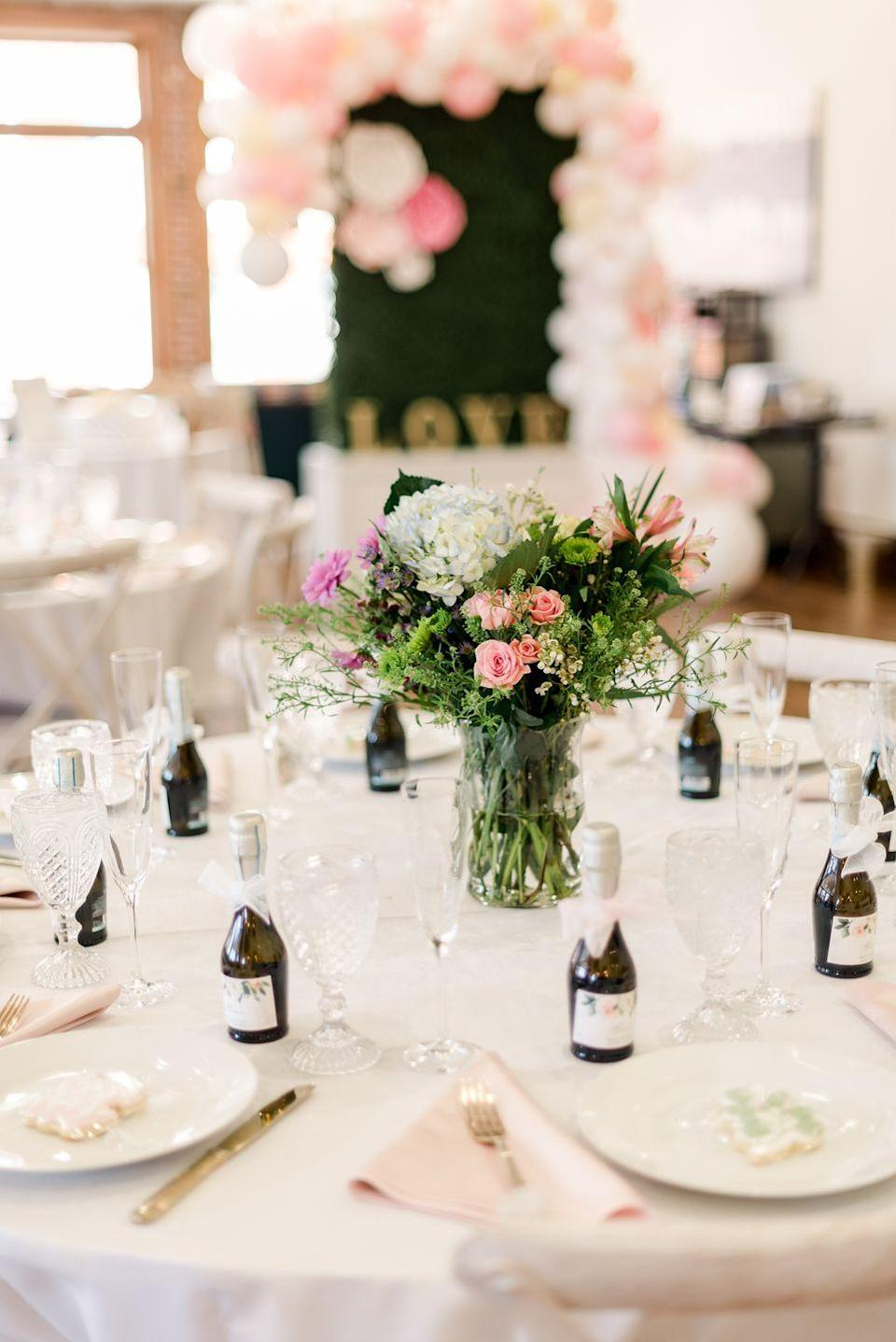 <p>Each place setting had a sweet, small bottle of champagne commemorating the occasion. (Hiccup!)</p>