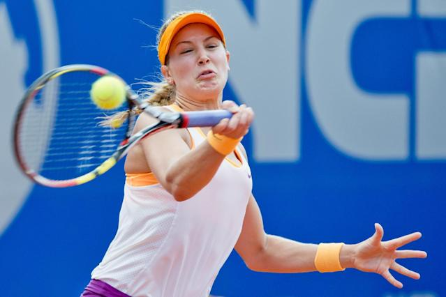 Canadian Eugenie Bouchard hits a forehand against Czech Karolina Pliskova at the WTA final in Nuremberg, Germany, Saturday, May 24, 2014. Bouchard won 6-2, 4-6, 6-3. (AP Photo/dpa, Daniel Karmann)