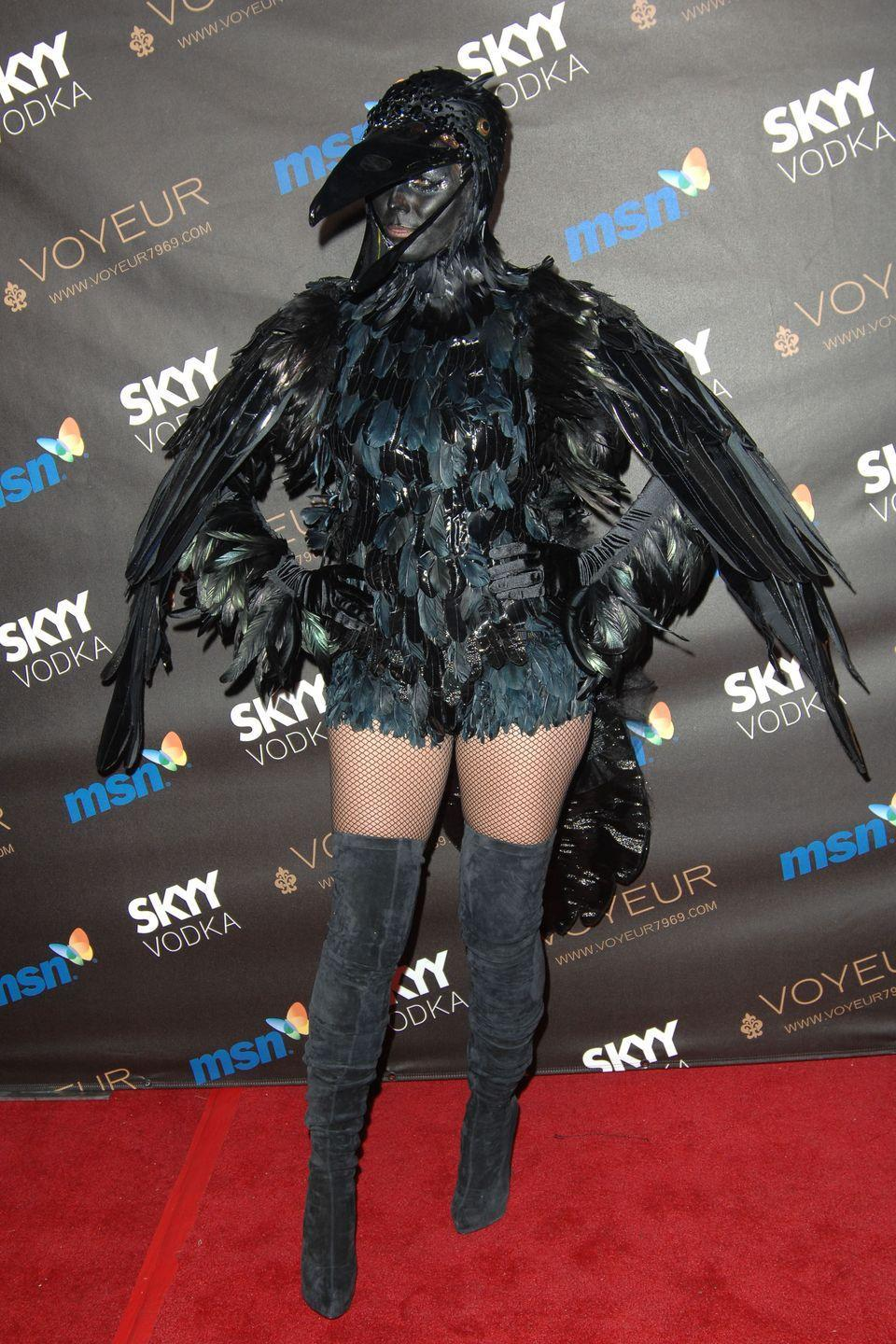 <p>What's better than one crow? A whole murder of 'em! Seal matched his then-wife in this intricate, feathered costume. To no one's surprise, the model admitted that the beak and wings made dancing, drinking, and eating nearly impossible. </p>