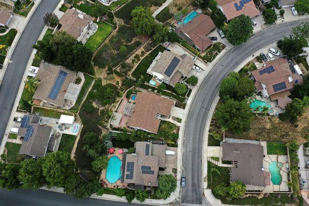 PHOTO: Solar panels are seen on rooftops, in Santa Clarita, near Los Angeles, Calif., June 18, 2020. (Lucy Nicholson/Reuters)