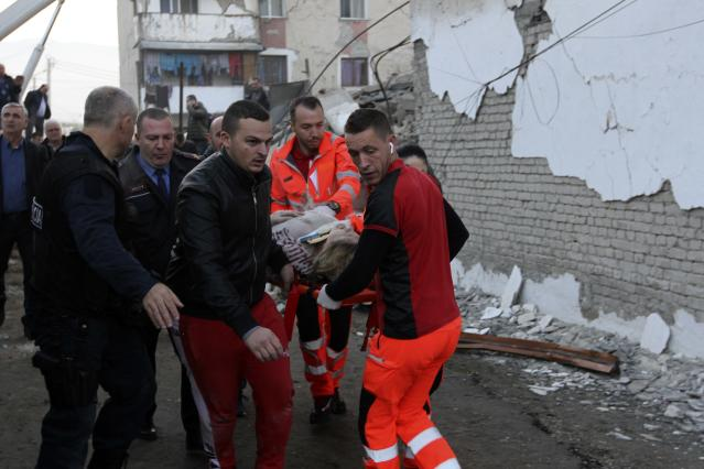 Rescuers carry an injured woman after a magnitude 6.4 earthquake in Thumane. Rescue crews used excavators to search for survivors trapped in toppled apartment buildings after a powerful pre-dawn earthquake in Albania. (Photo: Hektor Pustina/AP)