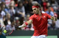 Roger Federer returns a ball to his opponent during the Davis Cup World Group playoff match between Switzerland and the Netherlands on September 20, 2015 in Geneva (AFP Photo/Fabrice Coffrini)