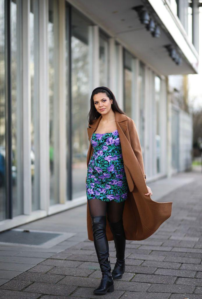 <p>Leather thigh-high boots might seem edgy, but you can totally balance that out with a fun floral dress, a romantic headband, and sophisticated camel coat. </p>