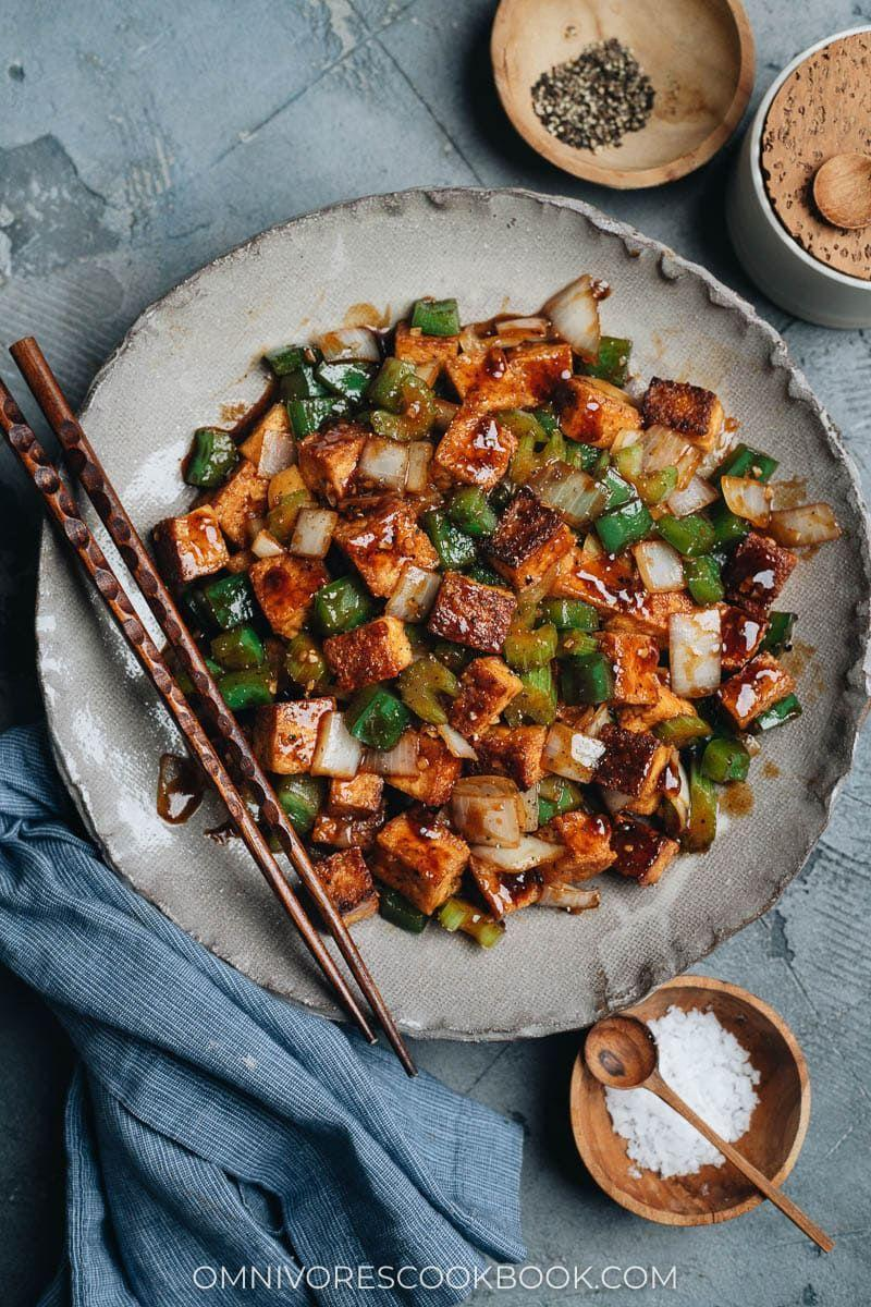 """<p>Similar to cauliflower, tofu tends to take on the flavor of whatever you season, coat, or cook it with. In exchange for 15 minutes of your time, you can make this black pepper tofu made with a soy sauce base. </p><p><strong><em>Get the recipe at <a href=""""https://omnivorescookbook.com/black-pepper-tofu/"""" rel=""""nofollow noopener"""" target=""""_blank"""" data-ylk=""""slk:Omnivore's Cookbook."""" class=""""link rapid-noclick-resp"""">Omnivore's Cookbook.</a></em></strong></p>"""