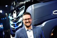 FILE PHOTO: CEO and founder of U.S. Nikola, Trevor Milton speaks during presentation of its new full-electric and hydrogen fuel-cell battery trucks in partnership with CNH Industrial, at an event in Turin